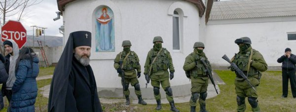 Archbishop Clement front of the goal Ukrainian military camp, March 2014