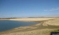 Обмелевшее Тайганское водохранилище,