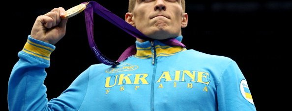 LONDON, ENGLAND - AUGUST 11:  Gold medalist Oleksandr Usyk of Ukraine celebrates on the podium during the medal ceremony for the Men's Heavy (91kg) Boxing final bout on Day 15 of the London 2012 Olympic Games at ExCeL on August 11, 2012 in London, England.  (Photo by Scott Heavey/Getty Images)